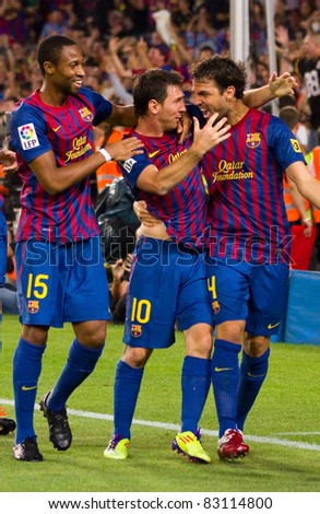 BARCELONA - AUGUST 17: Players celebrating the goal of Leo Messi (min. 88) during the Spanish Supercup final match between FC Barcelona and Real Madrid, 3 - 2, on August 17, 2011 in Barcelona, Spain. - stock photo