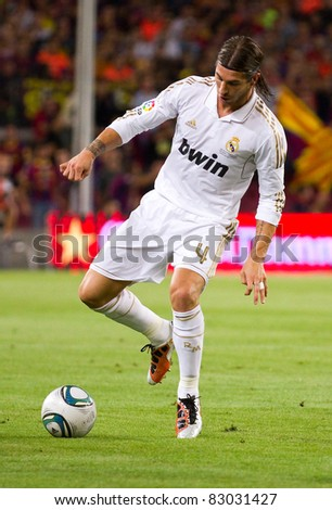 BARCELONA - AUGUST 17: Sergio Ramos of Madrid in action during the Spanish Supercup final match between FC Barcelona and Real Madrid, 3 - 2, on August 17, 2011 in Barcelona, Spain. - stock photo