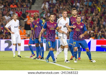 BARCELONA - AUGUST 17: Some players in action at the Spanish Super Cup final match between FC Barcelona and Real Madrid, 3 - 2, on August 17, 2011 in Camp Nou stadium, Barcelona, Spain. - stock photo
