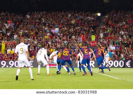 BARCELONA - AUGUST 17: Some players in action during the Spanish Supercup final match between FC Barcelona and Real Madrid, 3 - 2, on August 17, 2011 in Barcelona, Spain. - stock photo