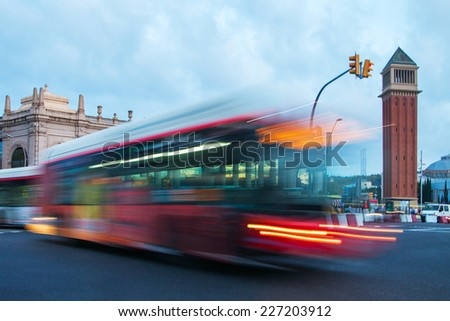 Barcelona city evening traffic in place of Espanya. - stock photo