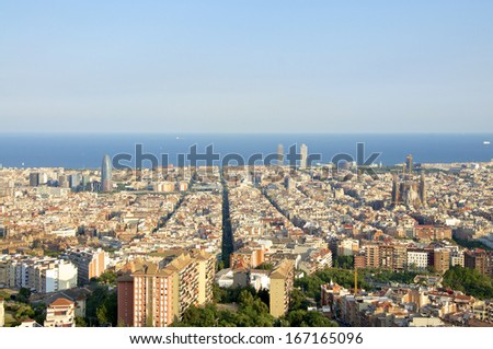 Barcelona, Cityscape. The Torre Agbar in the Barcelona district Poblenou. The Sagrada familia in the district Eixample. In front the Towers of the Port Olimpic. - stock photo