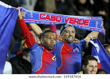 BARCELONA - DEC, 30: Cape Verdean supporters celebrating goal during the friendly match between Catalonia and Cape Verde at Olympic Stadium on December 30, 2013 in Barcelona, Spain. - stock photo