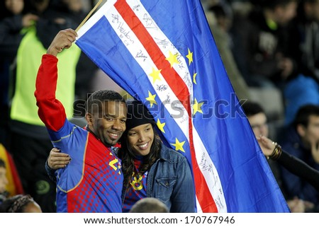 BARCELONA - DEC, 30: Cape Verdean supporters celebrating goal during the friendly match between Catalonia and Cape Verde at Olympic Stadium on December 30, 2013 in Barcelona, Spain - stock photo