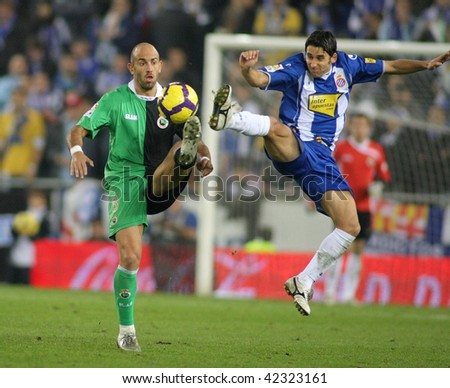 BARCELONA - DEC. 6: Colsa (L) of Santander with Corominas (R) of Espanyol during a Spanish League match between Espanyol and Santander at the Estadi Cornella on December 6, 2009 in Barcelona, Spain