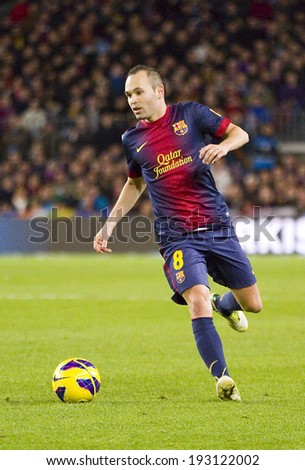 BARCELONA - DECEMBER 16: Andres Iniesta in action at the Spanish League match between FC Barcelona and Atletico de Madrid, final score 4 - 1, on December 16, 2012, in Camp Nou, Barcelona, Spain.