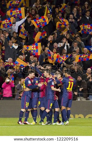 BARCELONA - DECEMBER 16: Barcelona players celebrating a goal during the Spanish League match between FC Barcelona and Atletico de  Madrid, final score 4 - 1, on December 16, 2012 in Barcelona, Spain. - stock photo