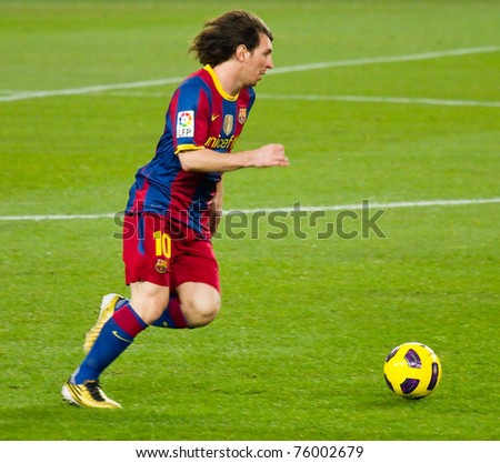 BARCELONA - DECEMBER 13:Leo Messi (10) in action during the Spanish Football League match between FC Barcelona and Real Sociedad, 5 - 0, in Camp Nou stadium. December 13, 2010 in Barcelona (Spain). - stock photo