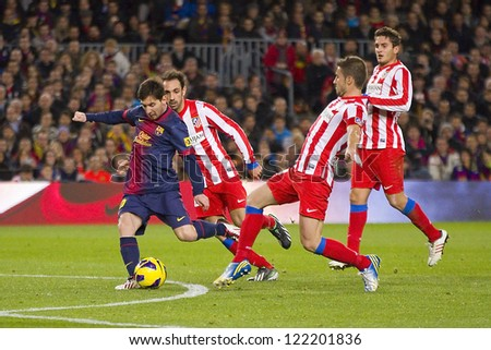 BARCELONA - DECEMBER 16: Lionel Messi (L) in action at the Spanish League match between FC Barcelona and Atletico de  Madrid, final score 4 - 1, on December 16, 2012, in Camp Nou, Barcelona, Spain. - stock photo