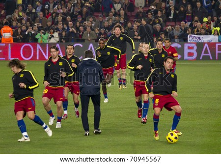 BARCELONA - DECEMBER 13: Nou Camp stadium, Spanish League match: FC Barcelona - Real Sociedad, 5 - 0. Warm-up of the team before the soccer match. December 13, 2010 in Barcelona (Spain). - stock photo