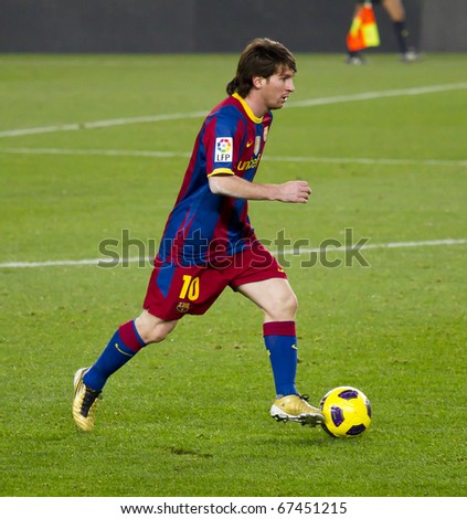 BARCELONA - DECEMBER 13: Nou Camp stadium, Spanish League Soccer match: FC Barcelona - Real Sociedad, 5 - 0. In the picture, Leo Messi in action. December 13, 2010 in Barcelona (Spain). - stock photo