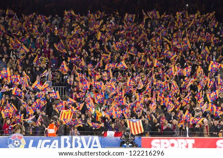 BARCELONA - DECEMBER 16: Unidentified supporters at the Spanish League match between FC Barcelona and Atletico de  Madrid, final score 4 - 1, on December 16, 2012, in Camp Nou, Barcelona, Spain. - stock photo