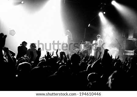 BARCELONA - FEB 15: Black and White picture of the crowd at the Kaiser Chiefs (famous British indie rock band) performs at Razzmatazz Clubs on February 15, 2014 in Barcelona, Spain. - stock photo