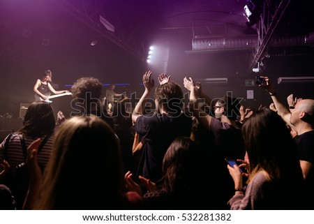 BARCELONA - FEB 6: Crowd clapping in a concert at Razzmatazz stage on February 6, 2016 in Barcelona, Spain.