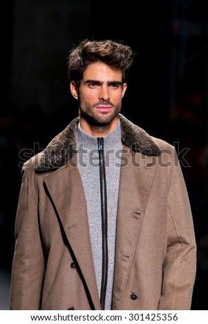 BARCELONA - FEB 5: Juan Betancourt (model) walks the runway for the Torras collection at the 080 Barcelona Fashion Week 2015 Fall Winter on February 5, 2015 in Barcelona, Spain. - stock photo