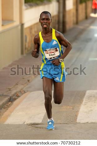 BARCELONA - FEB 6: Kenyan marathon runner Eric Kibet, running during Granollers Half Marathon at Granollers on February 6, 2011 in Barcelona, Spain - stock photo