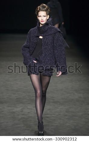 BARCELONA - FEBRUARY 02: a model walks on the Celia Vela catwalk during the 080 Barcelona Fashion runway Fall/Winter 2015 on February 02, 2015 in Barcelona, Spain.  - stock photo