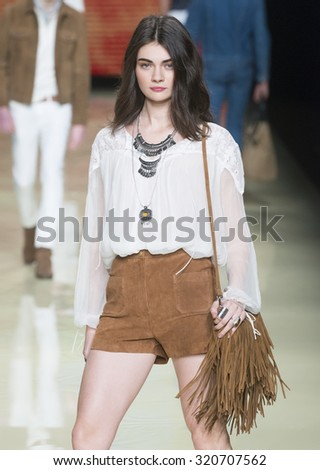 BARCELONA - FEBRUARY 02: a model walks on the Mango catwalk during the 080 Barcelona Fashion runway Fall/Winter 2015 on February 02, 2015 in Barcelona, Spain.  - stock photo