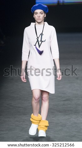 BARCELONA - FEBRUARY 04: a model walks on the Naulover catwalk during the 080 Barcelona Fashion runway Fall/Winter 2015 on February 04, 2015 in Barcelona, Spain.  - stock photo