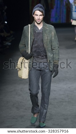 BARCELONA - FEBRUARY 05: a model walks on the Torras catwalk during the 080 Barcelona Fashion runway Fall/Winter 2015 on February 05, 2015 in Barcelona, Spain.  - stock photo