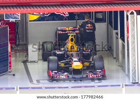 BARCELONA - FEBRUARY 24: Car of Red Bull F1 team in the pit during Formula One Teams Test Days at Catalunya circuit on February 24, 2012 in Barcelona, Spain. - stock photo
