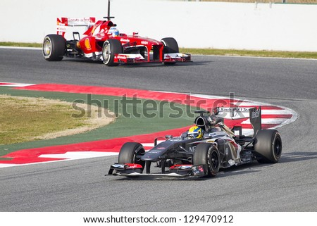 BARCELONA - FEBRUARY 19: Esteban Gutierrez (R) racing with his new Sauber C32 at Formula One Teams Test Days at Catalunya circuit on February 19, 2013 in Montmelo, Barcelona, Spain. - stock photo