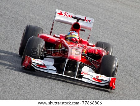BARCELONA - FEBRUARY 18: Fernando Alonso (Ferrari) driving his F1 car during Formula One Teams Test Days at Catalunya circuit, on February 18, 2011 in Barcelona, Spain. - stock photo