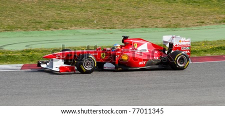 BARCELONA - FEBRUARY 18: Fernando Alonso (Ferrari) tests his F1 car during Formula One Teams Test Days at Catalunya circuit February 18, 2011 in Barcelona (Spain).
