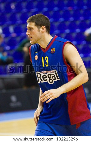 BARCELONA - FEBRUARY 29: Kosta Perovic of FCB in action during the Euroleague basketball match between FC Barcelona and Maccabi Tel Aviv, final score 70-67, on February 29, 2012, in Barcelona, Spain.