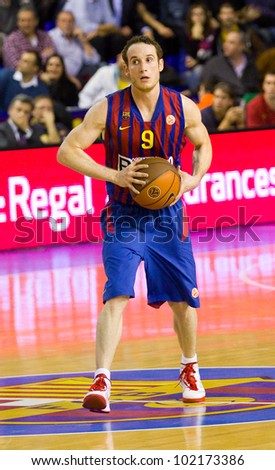 BARCELONA - FEBRUARY 29: Marcelinho Huertas in action during the Euroleague basketball match between FC Barcelona and Maccabi, final score 70-67, on February 29, 2012, in Barcelona, Spain. - stock photo