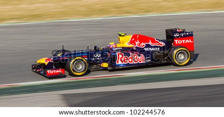 BARCELONA - FEBRUARY 24: Mark Webber of Red Bull F1 team racing at Formula One Teams Test Days at Catalunya circuit on February 24, 2012 in Barcelona, Spain. - stock photo