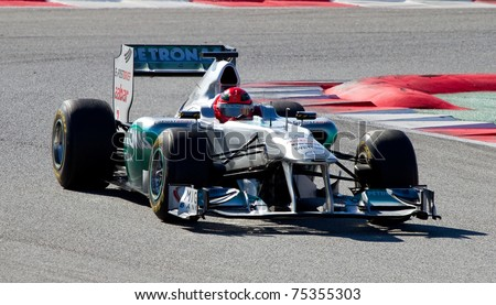BARCELONA - FEBRUARY 18: Michael Schumacher (Mercedes) tests his new F1 car during Formula One Teams Test Days at Catalunya circuit on February 18, 2011 in Barcelona, Spain. - stock photo