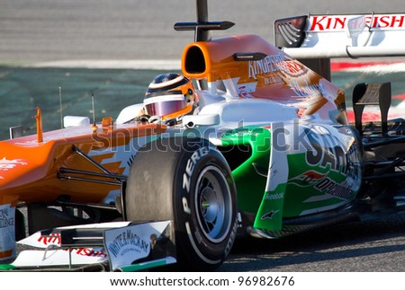 BARCELONA - FEBRUARY 21: Nico Hulkenberg of Force India F1 team races during Formula One Teams Test Days at Catalunya circuit on February 21, 2012 in Barcelona, Spain. - stock photo