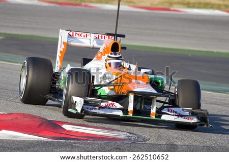 BARCELONA - FEBRUARY 21: Nico Hulkenberg of Force India F1 team racing at Formula One Teams Test Days at Catalunya circuit on February 21, 2012 in Barcelona, Spain. - stock photo