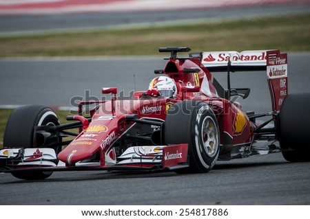 BARCELONA - FEBRUARY 21: Sebastian Vettel of Ferrari at third day of Formula One Test Days at Catalunya Circuit on February 21, 2015 in Barcelona, Spain. - stock photo