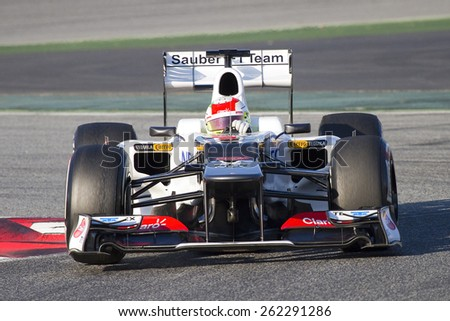 BARCELONA - FEBRUARY 21: Sergio Checo Perez of Sauber F1 team racing at Formula One Teams Test Days at Catalunya circuit on February 21, 2012 in Barcelona, Spain. - stock photo