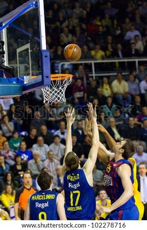 BARCELONA - FEBRUARY 29: Some players in action during the Euroleague basketball match between FC Barcelona and Maccabi Tel Aviv, final score 70-67, on February 29, 2012, in Barcelona, Spain. - stock photo