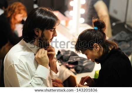 BARCELONA - JAN 13: An actor Theater Institute, dresses and prepares to go on stage in the comedy Shakespeare For Executives on January 13, 2013 in Barcelona, Spain. - stock photo