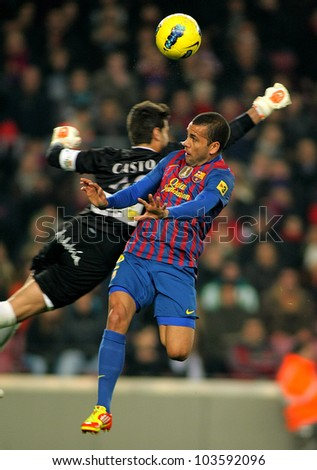 BARCELONA - JAN, 15: Dani Alves of FC Barcelona during the Spanish league match between FC Barcelona and Real Betis at the Camp Nou stadium on January 15, 2012 in Barcelona, Spain - stock photo
