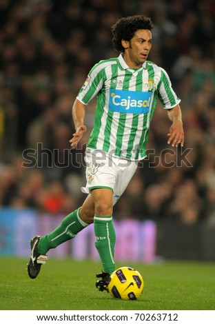 BARCELONA - JAN 12: Iriney of Betis in action during the match between FC Barcelona and Real Betis at the Nou Camp Stadium on January 12, 2011 in Barcelona, Spain - stock photo