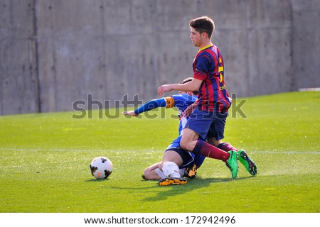 BARCELONA - JAN 19: Julen Arellano plays with F.C Barcelona youth team against Figueres on January 19, 2014 in Barcelona, Spain. - stock photo