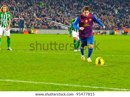 BARCELONA – JAN 15: Leo Messi (R) in a penalty kick during the match between FC Barcelona vs Real Betis, 4 - 2, in Camp Nou stadium on January 15, 2012, Barcelona, Spain. - stock photo