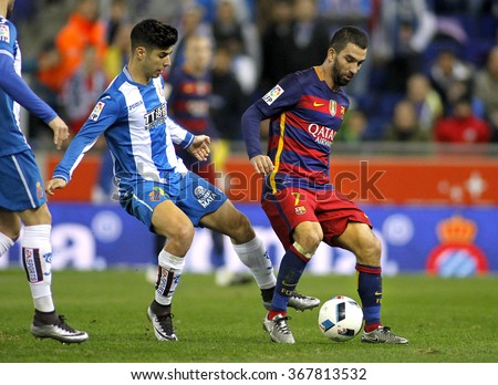 BARCELONA - JAN, 13: Marco Asensio(L) of RDC Espanyol vies with Arda Turan(R) of FC Barcelona during a Spanish Cup match at the Power8 stadium on January 13, 2016 in Barcelona, Spain - stock photo