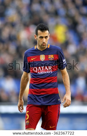 BARCELONA - JAN, 2: Sergio Busquets of FC Barcelona during a Spanish League match against RCD Espanyol at the Power8 stadium on January 2, 2016 in Barcelona, Spain - stock photo