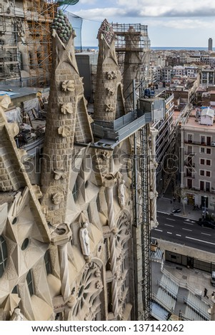 BARCELONA - JAN 17:  View of Sagrada Familia cathedral is shown on January 17, 2013 in Barcelona, Catalonia, Spain. Sagrada Familia was designed by Antoni Gaudi and has been in construction since 1882
