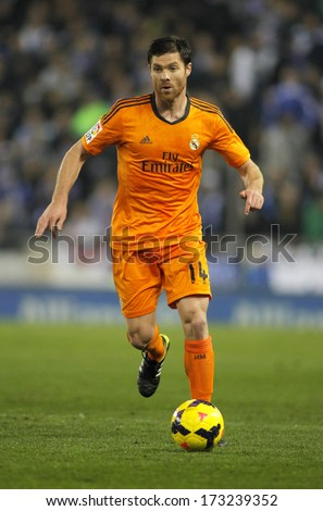 BARCELONA - JAN, 12: Xabi Alonso of Real Madrid during the Spanish League match between Espanyol and Real Madrid at the Estadi Cornella on January 12, 2014 in Barcelona, Spain - stock photo