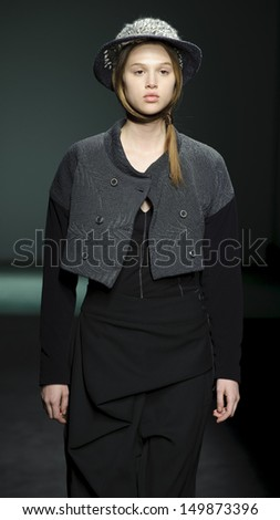BARCELONA - JANUARY 30: A model walks on the Miriam Ponsa catwalk during the 080 Barcelona Fashion runway on January 30, 2013 in Barcelona, Spain.