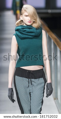 BARCELONA - JANUARY 30: A model walks on the Yerse catwalk during the 080 Barcelona Fashion runway Fall/Winter 2014 on January 30, 2014 in Barcelona, Spain.