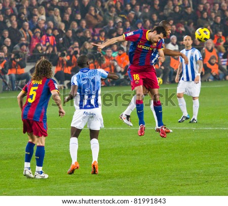 BARCELONA - JANUARY 16: Carlos Busquets (16) in action during Spanish League match between FC Barcelona and Malaga, 4 - 1. January 16, 2011 in Camp Nou stadium, Barcelona, Spain. - stock photo
