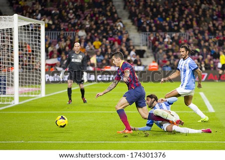BARCELONA - JANUARY 26: Cristian Tello (L) in action at Spanish league match between FC Barcelona and Malaga CF, final score 3-0, on January 26, 2014, in Barcelona, Spain. - stock photo